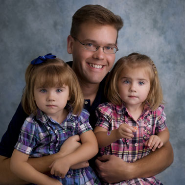 Dad's Guide to Twins blog author and his twin daughters