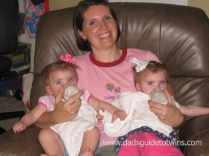 feeding twins on lap