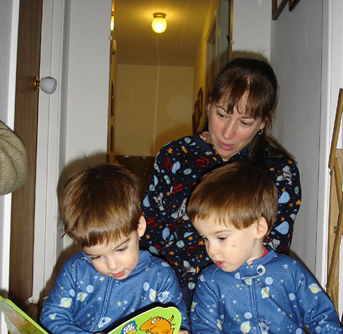 Twins reading with mom